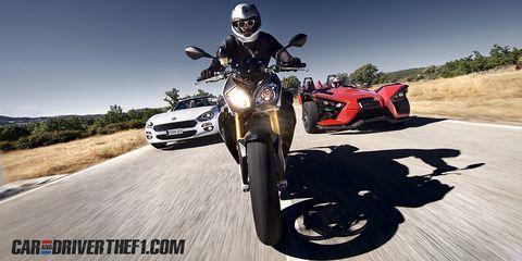 Motor vehicle, Motorcycle, Automotive design, Automotive tire, Vehicle, Land vehicle, Automotive lighting, Automotive exterior, Automotive wheel system, Rim,
