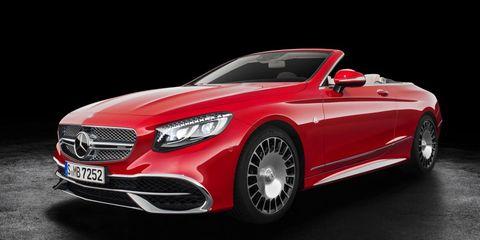 Tire, Mode of transport, Automotive design, Vehicle, Automotive lighting, Grille, Headlamp, Red, Car, Hood,
