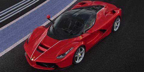 Tire, Wheel, Mode of transport, Automotive design, Land vehicle, Vehicle, Car, Rim, Red, Vehicle door,