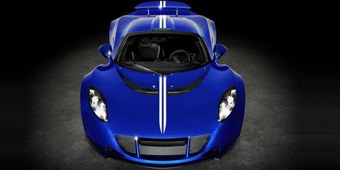 Automotive design, Blue, Mode of transport, Vehicle, Hood, Automotive exterior, Headlamp, Automotive lighting, Car, Electric blue,