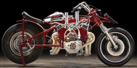 Tire, Wheel, Motorcycle, Automotive tire, Transport, Rim, Automotive design, Fuel tank, Spoke, Fender,