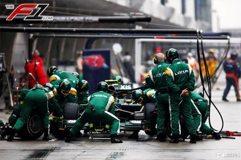 Green, Personal protective equipment, Team, Sports gear, Race track, Toy, Emergency service, Helmet, Service, Crew,