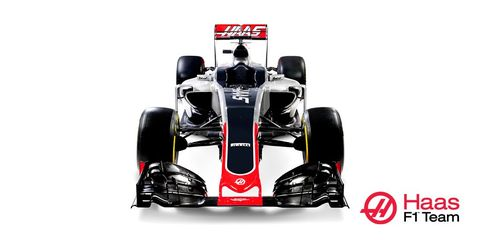 Automotive tire, Automotive design, Open-wheel car, Automotive exterior, Red, Automotive wheel system, Logo, Formula one car, Formula one, Formula one tyres,