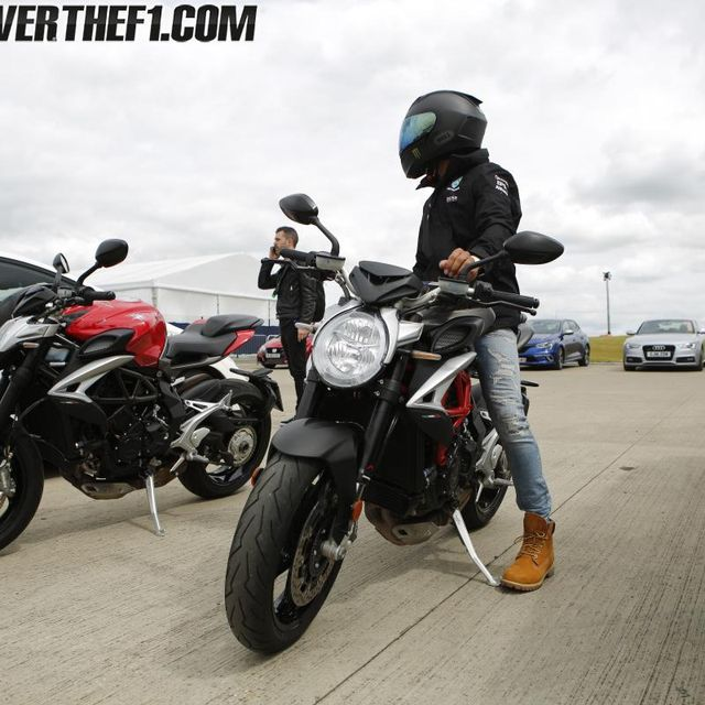 Tire, Motor vehicle, Wheel, Motorcycle, Automotive tire, Automotive design, Land vehicle, Motorcycle helmet, Vehicle, Automotive wheel system,