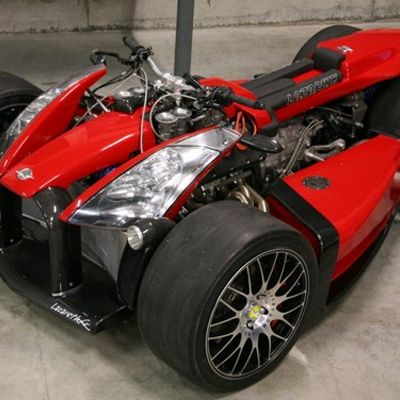 Tire, Wheel, Automotive tire, Automotive design, Open-wheel car, Automotive wheel system, Rim, Red, Automotive exterior, Spoke,