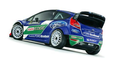 Wheel, Tire, Blue, Automotive design, Vehicle, Car, Rim, Automotive decal, Alloy wheel, Hatchback,