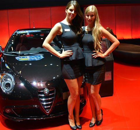 Automotive design, Land vehicle, Car, Human leg, High heels, Auto show, Sunglasses, Exhibition, Automotive lighting, Grille,