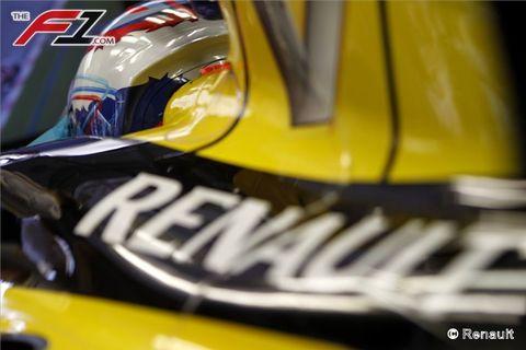 Yellow, Automotive exterior, Logo, Helmet, Automotive decal, Hood, Race car, Symbol, Racing, Touring car racing,