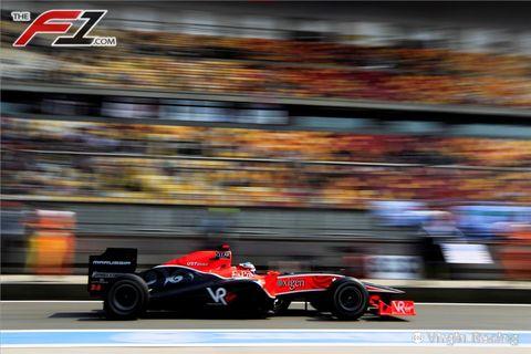 Tire, Wheel, Automotive tire, Automotive design, Open-wheel car, Vehicle, Motorsport, Formula one car, Sport venue, Car,