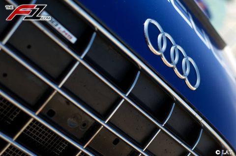Automotive design, Text, Grille, Logo, Font, Electric blue, Symbol, Close-up, Metal, Brand,