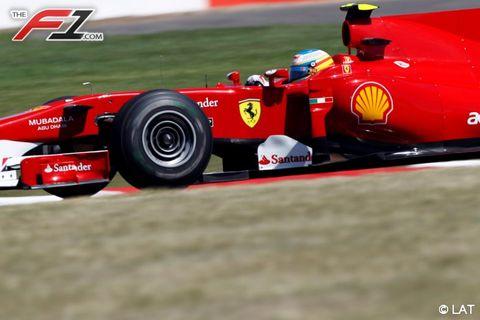 Tire, Automotive tire, Automotive design, Vehicle, Open-wheel car, Race track, Formula one, Formula one tyres, Red, Automotive wheel system,