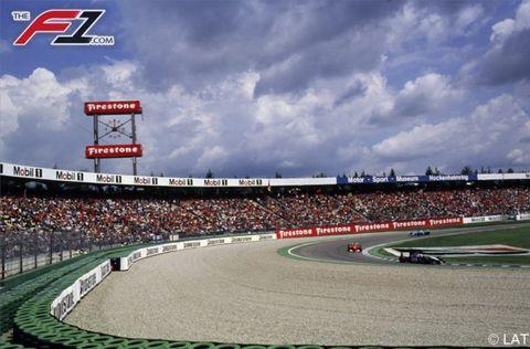 Sport venue, Race track, Competition event, Racing, Logo, Stadium, Cumulus, Auto racing, Arena, Signage,