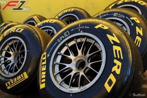 Automotive tire, Automotive design, Yellow, Rim, Automotive wheel system, Alloy wheel, Formula one tyres, Spoke, Synthetic rubber, Logo,