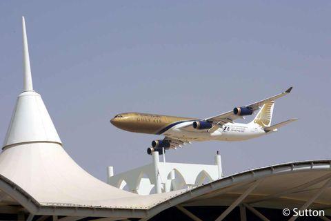 Airplane, Sky, Aircraft, Flight, Architecture, Air travel, Aerospace engineering, Aviation, Wing, Landmark,