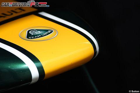 Yellow, Logo, Symbol, Trademark, Brand, Label, Macro photography, Gloss, Graphics,