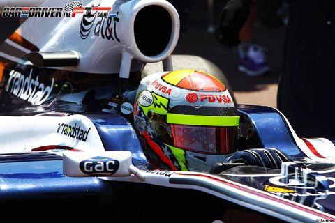 Personal protective equipment, Helmet, Motorcycle helmet, Logo, Racing, Headgear, Sports gear, Motorsport, Championship, Auto racing,