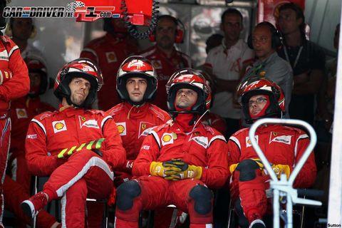 People, Sports gear, Helmet, Social group, Sports uniform, Red, Jersey, Personal protective equipment, Sportswear, Team,