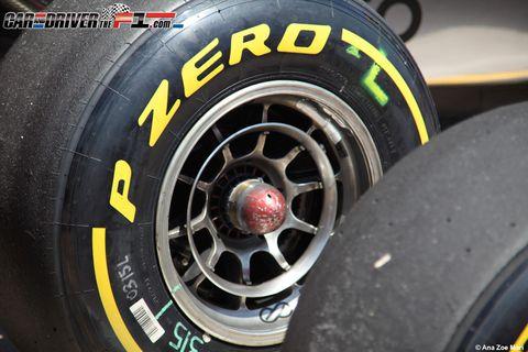 Motor vehicle, Tire, Automotive tire, Automotive design, Automotive wheel system, Rim, Synthetic rubber, Formula one tyres, Spoke, Auto part,