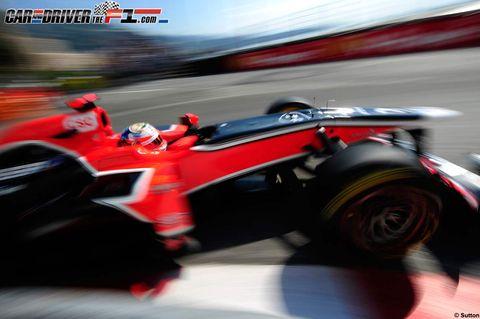 Automotive design, Automotive tire, Open-wheel car, Red, Motorsport, Fender, Automotive wheel system, Race track, Helmet, Racing,