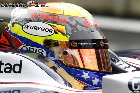 Yellow, Motorcycle helmet, Personal protective equipment, Logo, Helmet, Sports gear, Headlamp, World, Automotive decal, Race car,