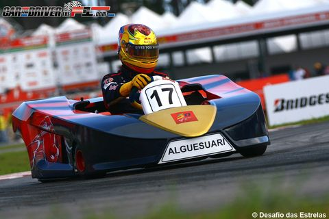 Automotive design, Mode of transport, Helmet, Automotive exterior, Sports gear, Race track, Racing, Personal protective equipment, Competition event, Logo,