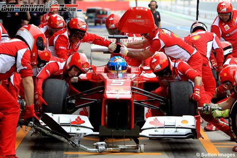 Automotive design, Helmet, Sports gear, Personal protective equipment, Red, Motorsport, Racing, Automotive tire, Competition event, Open-wheel car,