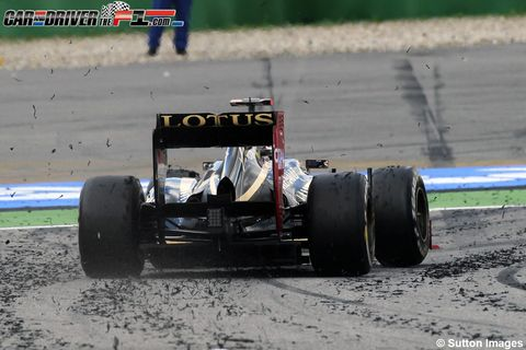 Tire, Wheel, Automotive tire, Automotive design, Open-wheel car, Automotive wheel system, Formula one tyres, Sport venue, Auto part, Competition event,