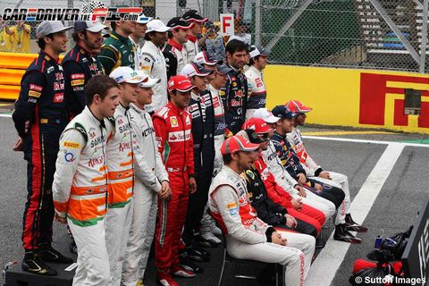 Uniform, Hat, Team, Logo, Race track, Crew, Fan, Touring car racing, Race car, Stadium,
