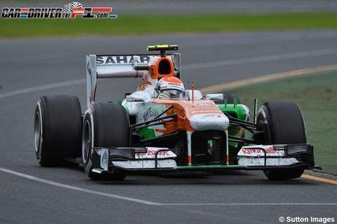 Tire, Wheel, Automotive tire, Open-wheel car, Automotive design, Mode of transport, Formula one tyres, Formula one car, Green, Motorsport,
