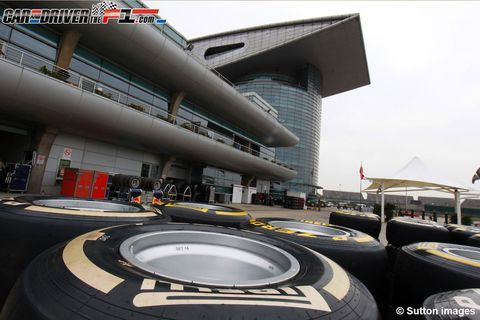 Automotive tire, Automotive wheel system, Synthetic rubber, Race track, Auto part, Tread, Formula one tyres, Composite material, Commercial building, Circle,
