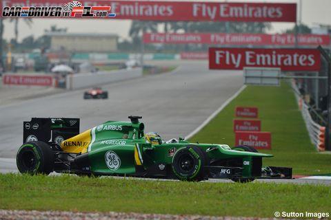 Tire, Automotive tire, Automotive design, Open-wheel car, Green, Race track, Formula one car, Motorsport, Formula one, Formula one tyres,