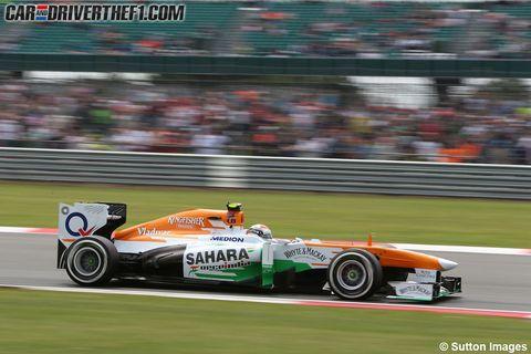 Tire, Wheel, Automotive tire, Automotive design, Vehicle, Green, Race track, Automotive wheel system, Motorsport, Racing,