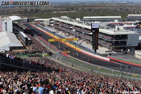 Crowd, People, Sport venue, Audience, Fan, Urban area, Stadium, Urban design, Public event, Race track,