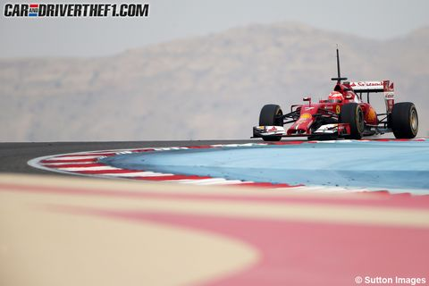 Tire, Automotive tire, Automotive design, Open-wheel car, Sport venue, Formula one tyres, Formula one, Formula one car, Automotive wheel system, Red,