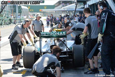 Automotive tire, Logo, Crew, Sunglasses, Automotive wheel system, Pedestrian, Race car, Formula one tyres, Physical fitness, Passenger,