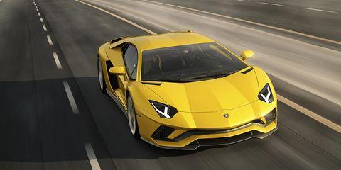 Motor vehicle, Road, Mode of transport, Automotive design, Transport, Yellow, Automotive exterior, Vehicle, Hood, Land vehicle,