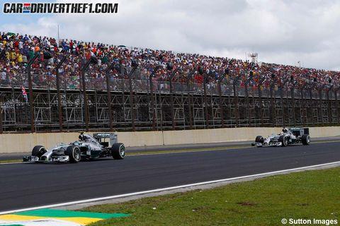 Tire, Automotive tire, Race track, Vehicle, Sport venue, Land vehicle, Automotive design, Motorsport, Car, Racing,