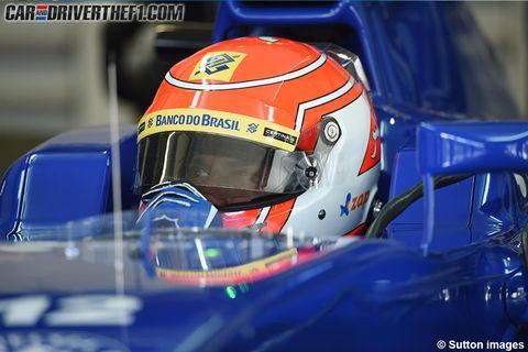Automotive design, Mode of transport, Motorcycle helmet, Helmet, Personal protective equipment, Sports gear, Logo, Race car, Headlamp, Electric blue,