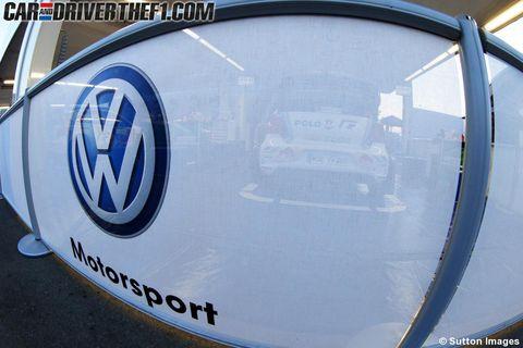 Motor vehicle, Blue, Azure, Logo, Symbol, Circle, Electric blue, Trademark, Emblem, Number,