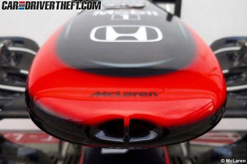 Automotive design, Red, Carmine, Orange, Motorcycle accessories, Bumper, Carbon, Brand, Grille, Symbol,