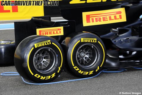 Automotive tire, Automotive design, Automotive wheel system, Rim, Synthetic rubber, Auto part, Alloy wheel, Formula one tyres, Automotive exterior, Logo,