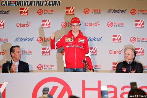 Red, Logo, Cap, Baseball cap, Brand, Spokesperson, Bottle, News conference,