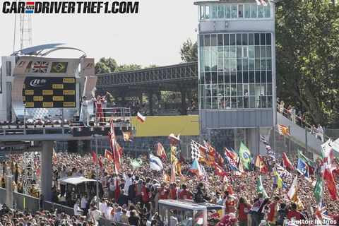 Crowd, Display device, Flag, Parade, Stage equipment, Public event, Scoreboard, Audience, Advertising, Fan,