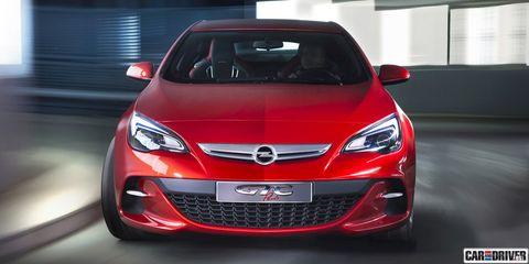 Automotive design, Vehicle, Car, Automotive lighting, Glass, Grille, Red, Hood, Bumper, Headlamp,