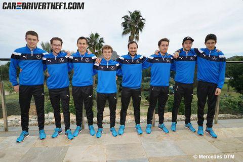 Sports uniform, Social group, Team, Uniform, Jersey, Active shorts, Arecales, Sports jersey, Crew, Palm tree,