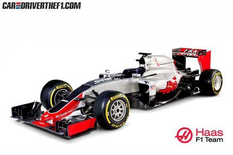 Tire, Wheel, Automotive tire, Automotive design, Open-wheel car, Automotive wheel system, Vehicle, Red, Rim, Automotive exterior,