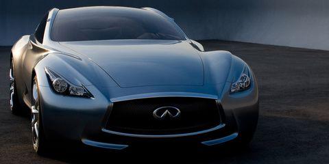 Automotive design, Blue, Daytime, Vehicle, Glass, Headlamp, Automotive mirror, Grille, Hood, Car,