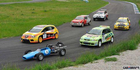 Wheel, Tire, Vehicle, Land vehicle, Motorsport, Car, Automotive design, Automotive decal, Race car, Automotive tire,