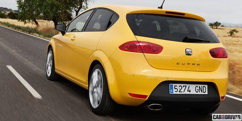 Motor vehicle, Tire, Mode of transport, Automotive design, Daytime, Vehicle, Yellow, Land vehicle, Automotive exterior, Infrastructure,