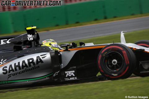 Automotive tire, Automotive design, Green, Open-wheel car, Race track, Formula one tyres, Automotive wheel system, Motorsport, Formula one, Sport venue,